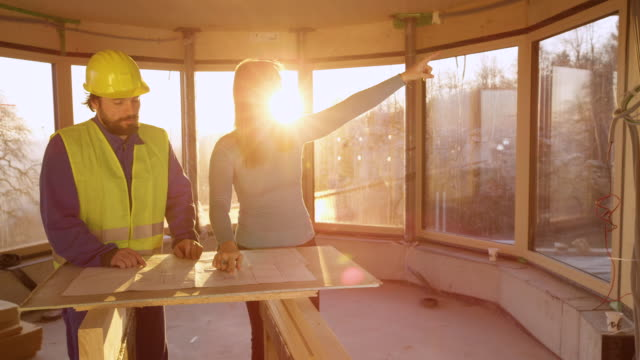 LENS FLARE: Angry woman reprimands engineer for not working according to plans. video