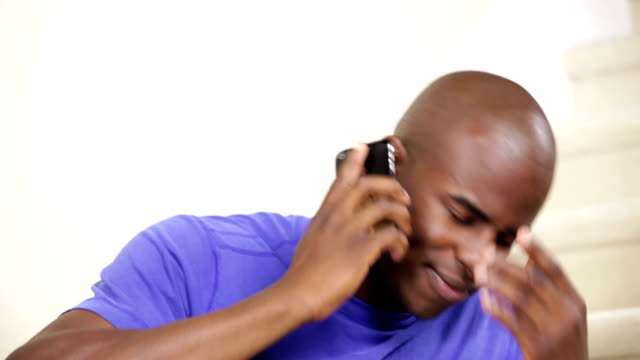 Angry young man talking on the phone video