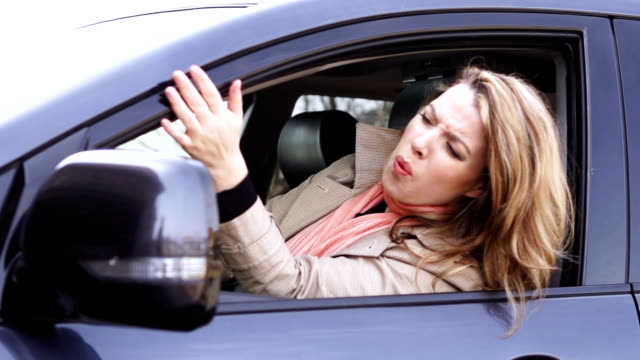 Angry young woman in the car Angry young woman getting upset by the traffic - slow motion 240 FPS angry stock videos & royalty-free footage