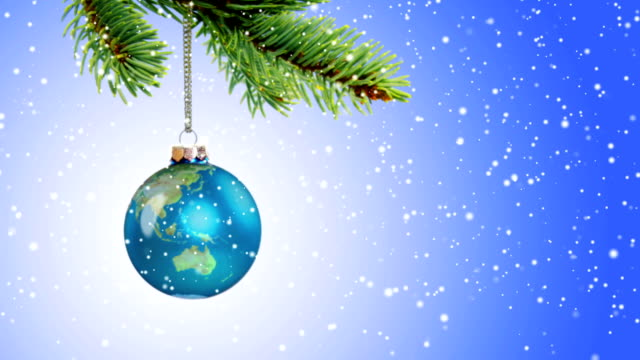 Animated Earth Globe Ornament Hanging From Christmas Tree Branch video
