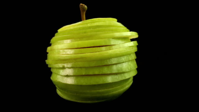 animated funky fresh apple sliced and put back together again. fun stop motion animation for creative cooking and health awareness concepts - plasterek filmów i materiałów b-roll
