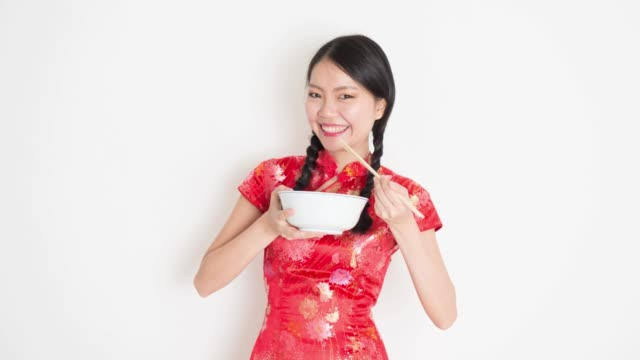 Animated image of Asian woman eating video