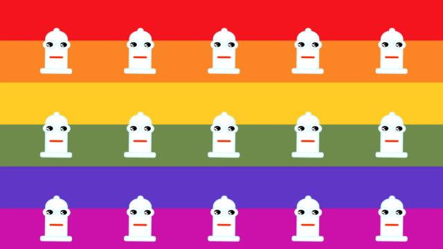 gökkuşağı bayrağı arka plan ile cinsel security için mutlu bir prezervatif temsil eden animasyon desen - penis stok videoları ve detay görüntü çekimi