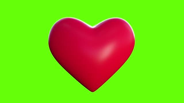 緑色の画面の前で赤い心臓が鼓動するアニメーション。これはまた、医療やヘルスケアのテーマを持つビデオで使用することができます - 心臓点の映像素材/bロール