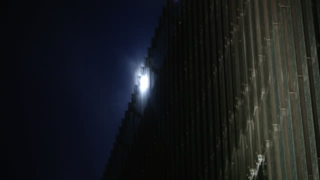 Animated skyscraper. Clear sky in the background. Shoot with anamorphic lenses