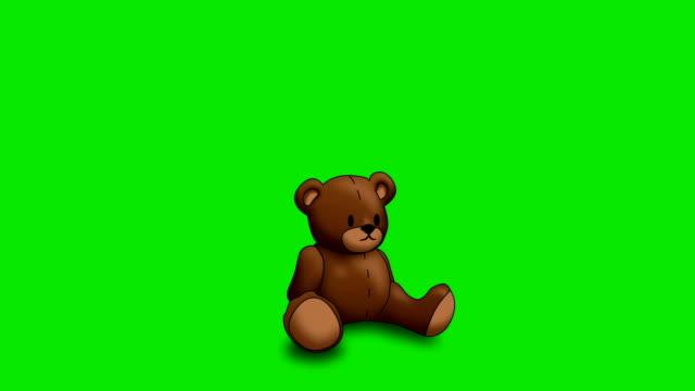 グリーン上のアニメーションのテディー ・ ベア ビデオ