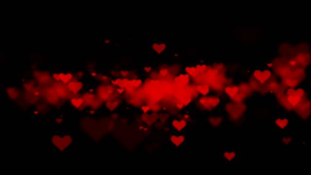animated valentine hearts on black background - simbolo concettuale video stock e b–roll