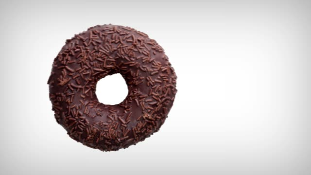 Animation. A donut with chocolate is eaten on white background. Top view