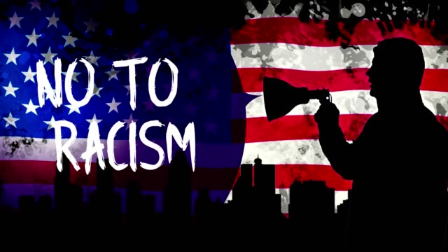 Animation. black silhouette of protester holds megaphone, shouts out slogan - NO TO RACISM. background is of waving USA flag, skyscrapers black silhouettes, city video