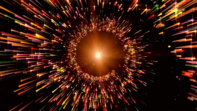 анимация движения фон летающих световых частиц в световых лучах. разноцветный.  взрыв. фейерверк. - white background стоковые видео и кадры b-roll