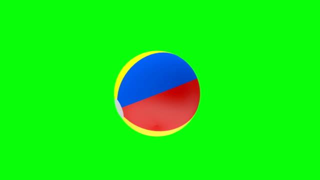 3D animation of a beach ball rotation on a green screen. 4K