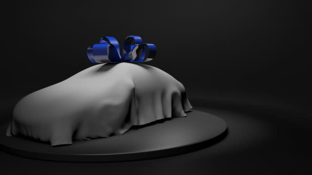 3D animation of a brand new automobile covered by a sheet with a shiny blue ribbon video