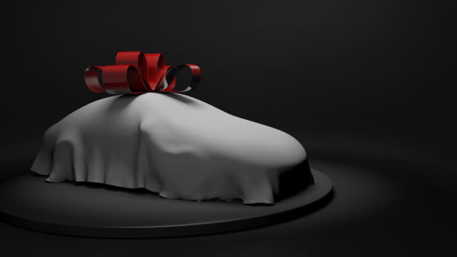 3D animation of a luxury car wrapped under a sheet with a big red bow video
