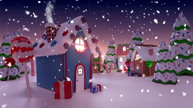 animation einer verschneiten stadt zu weihnachten - lebkuchenhaus stock-videos und b-roll-filmmaterial