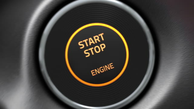 CG animation of a working V8 engine with start stop button. Pressing the button to start the car engine. Then camera zooming to a moving v8 engine in flames. push button stock videos & royalty-free footage