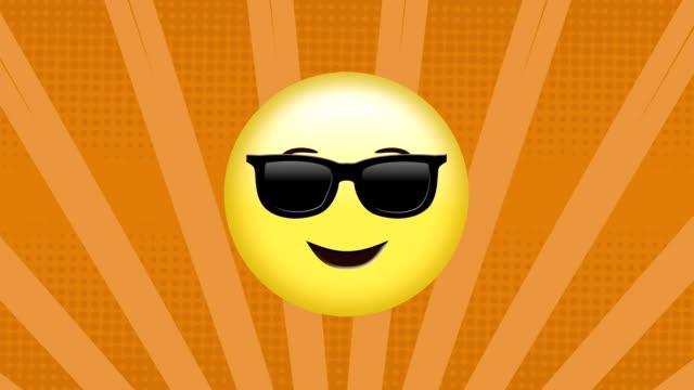 animation von coolen emoji-symbol in sonnenbrille auf rotierenden orangen streifen in nahtloser schleife bewegen - smiley stock-videos und b-roll-filmmaterial