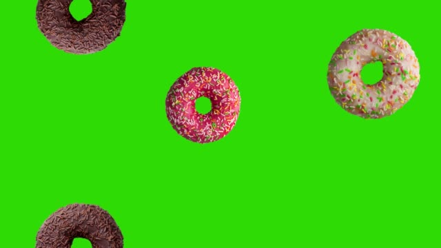 animation of falling tasty donuts on green screen. animation of seamless loop, 4k - bombolone video stock e b–roll