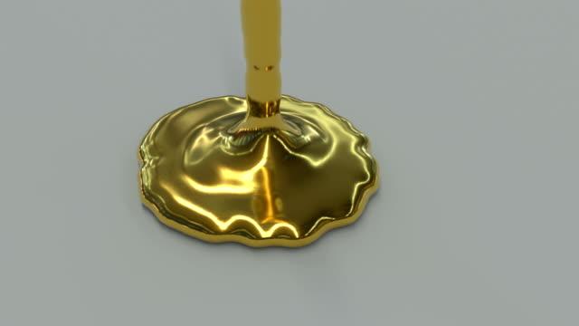 altın sıvı dökme animasyon. - altın metal stok videoları ve detay görüntü çekimi