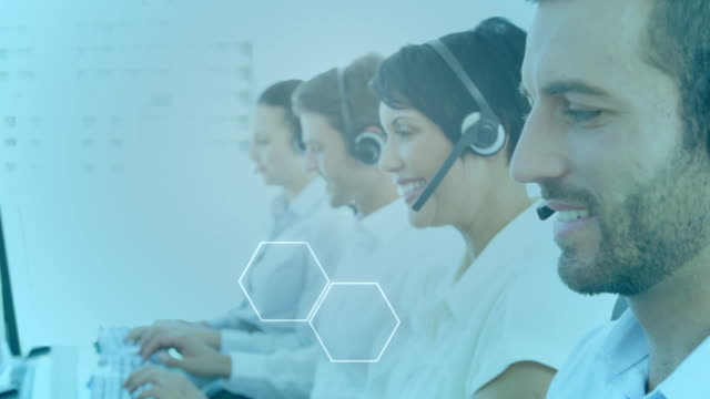 Animation of group of multi-ethnic call centre workers wearing headsets and using computers in offic