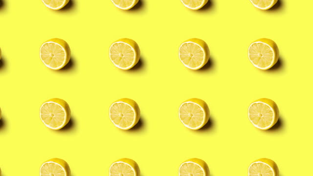 animation of lemons pattern on yellow background - gusto aspro video stock e b–roll