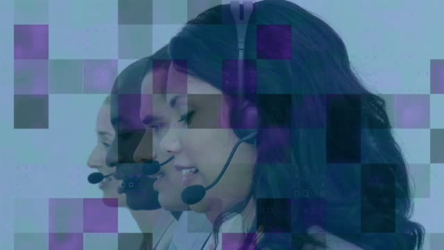 animation of pixels flashing over multi-ethnic group of call centre workers wearing headsets - shifts call centre video stock e b–roll