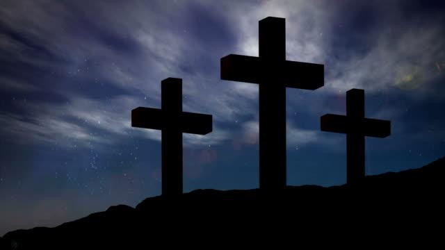 animation av silhuett av tre kristna kors över månen och solen - krucifix bildbanksvideor och videomaterial från bakom kulisserna