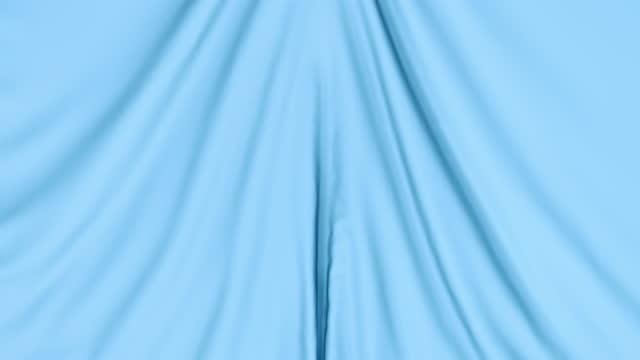 ブルーのカーテンファブリックのアニメーション。 - 布点の映像素材/bロール