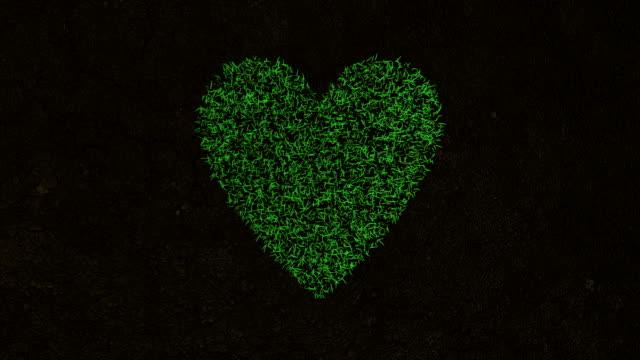 animación 3D del símbolo del corazón en hierba verde fresca. - vídeo