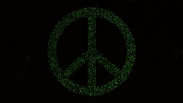 3D-Animation des Friedenssymbols auf frischem, grünem Gras. – Video