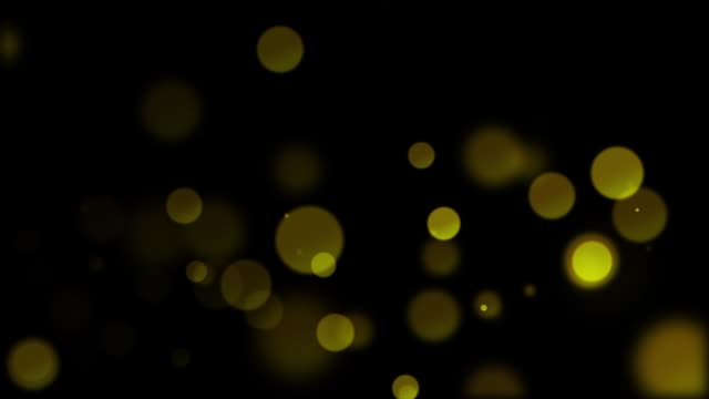 animation of unfocused rounded elements appearing on a black background hd - comparsa video stock e b–roll