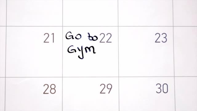 animation skrift gå till gymmet märkning dagen i kalendern med svart bläck - calendar workout bildbanksvideor och videomaterial från bakom kulisserna