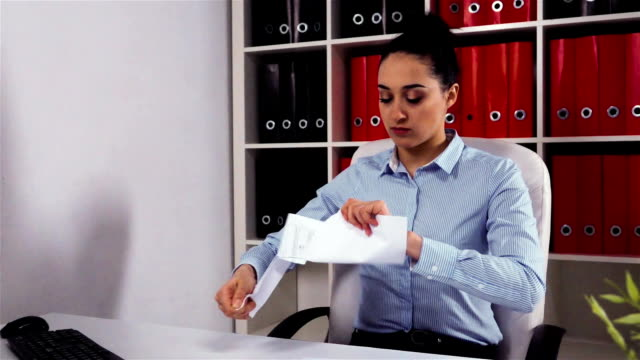 Annoyed businesswoman tears the document work contract video