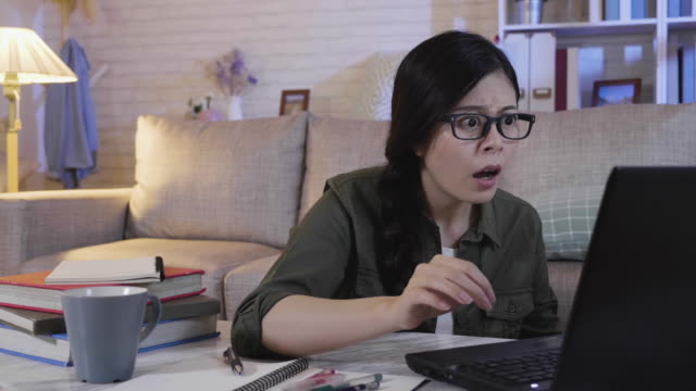 annoyed woman confuse by notebook crush