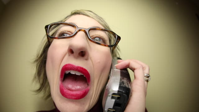 Annoying Fisheye Woman Talking on Cordless Phone An HD fisheye video clip of an annoying woman talking in high speed on a cordless telephone. cordless phone stock videos & royalty-free footage