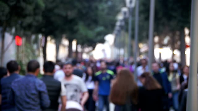 anonymous crowd of people walking on city street in blur. slow motion - anonymous hackers stock videos and b-roll footage
