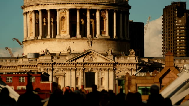 Anonymous crowds walking past the famous St Pauls Cathedral in London, England, UK on a sunny day video