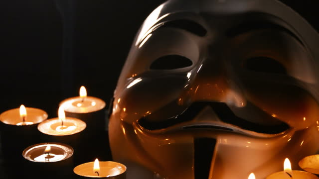 anonymous, face mask v vendetta with candles. - anonymous hackers stock videos and b-roll footage