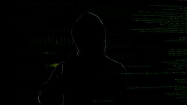 vídeos de stock e filmes b-roll de anonymous hacker swiping and scrolling virtual screen, stealing secret data - capuz
