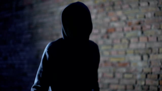 vídeos de stock e filmes b-roll de anonymous hooligan threatening with gun, robbery aggression, armed criminal - roubar crime