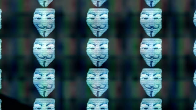 Anonymous mask on tv screen eternal zoom Anonymous mask on tv screen eternal zoom identity theft stock videos & royalty-free footage