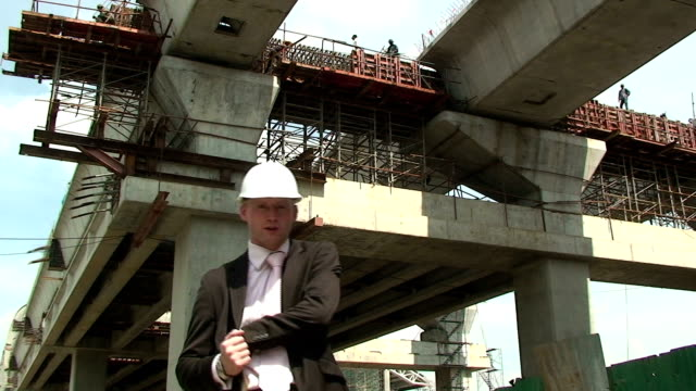 Answering the Phone A Construction manager uses the mobile phone. craftsman architecture stock videos & royalty-free footage