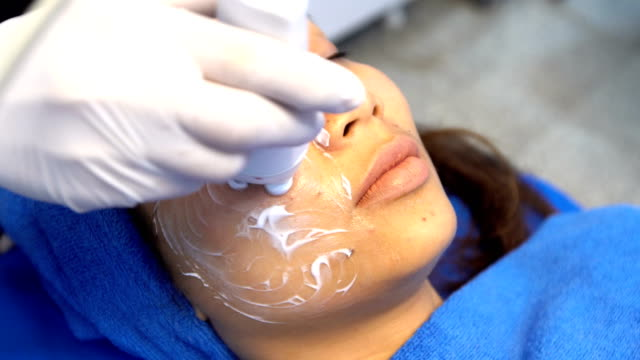 Anti Aging Facial treatment with Cream massage on woman face video