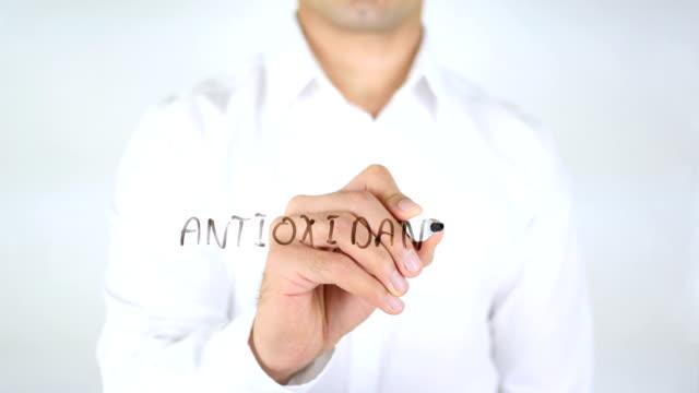 Antioxidants, Man Writing on Glass video