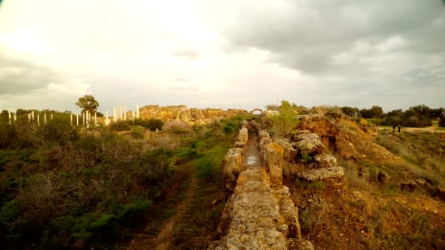 Antique aqueduct far columns ancient town Salamis Cyprus Famagusta video