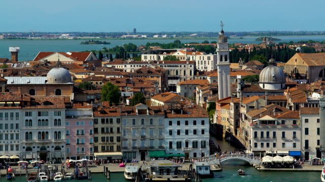 Antique architecture of Venice, view of buildings and tourists walking on bridge video
