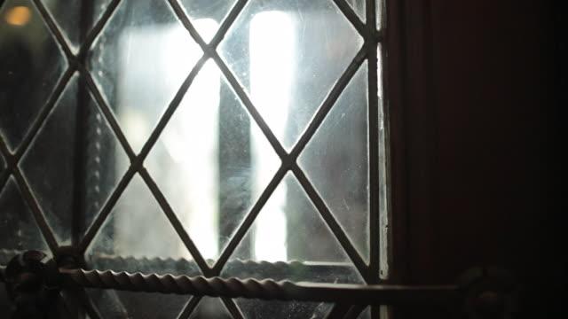 Antique european windows inside catholic church, Grungy looking glass