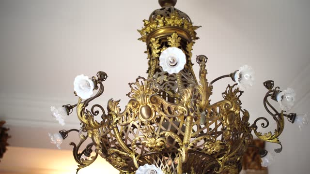 Antique gold chandelier with patterns. Royal interiors of castles. Antique gold chandelier with patterns. Royal interiors of castles. High quality photo victorian architecture stock videos & royalty-free footage