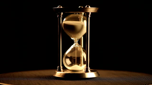 Antique hourglass Antique hourglass. Beginning of a cycle (rapid) hourglass stock videos & royalty-free footage
