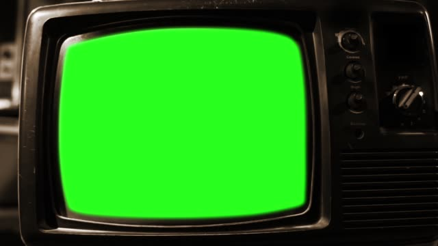 "Antique TV with Green Screen. Aesthetics of the 80s. Sepia Tone. Zoom Out. Antique TV with Green Screen. Aesthetics of the 80s. Sepia Tone. Zoom Out. You can replace green screen with the footage or picture you want. You can do it with ""Keying"" (Chroma Key) effect in Adobe After Effects or other video editing software (check out tutorials on YouTube). Full HD. the past stock videos & royalty-free footage"