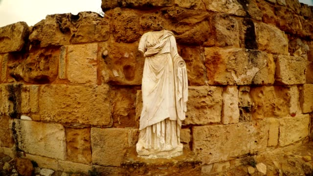 Antique white headless statue ruins ancient town Salamis east Cyprus Famagusta video